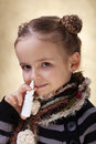 Little girl with nasal spray fighting the flu cold and Royalty Free Stock Photos
