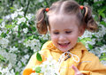 Little girl near blossoming apple tree happy at spring Stock Photography