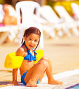 Little girl near pool cute sitting active happy childhood summer holidays having fun outdoors wearing swimwear joy and pleasure Royalty Free Stock Photos