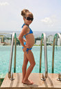 Little girl near roof top pool Royalty Free Stock Photo