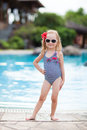 Little girl near swimming pool portrait of adorable a Stock Images