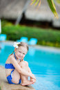 Little girl near swimming pool portrait of adorable sitting a Stock Photos