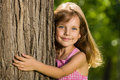 Little girl near a tree Royalty Free Stock Photo