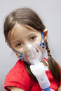 Little girl with nebulizer Stock Photos
