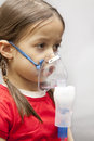 Little girl with nebulizer Royalty Free Stock Photo