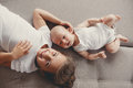 Little girl with a newborn baby brother five years old brunette dressed in white shirt and white pants spends time together her Stock Photography