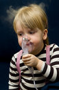 Little girl nose inhalator Royalty Free Stock Photography