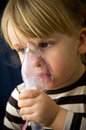 Little girl nose inhalator Stock Image