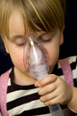 Little girl nose inhalator Royalty Free Stock Images