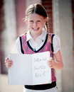 Little girl with notebook smart girls rock smiling holding that says Royalty Free Stock Photo