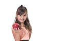 Little girl is offering a red apple in her hand