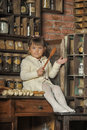 Little girl on the old kitchen photos in retro style Royalty Free Stock Images