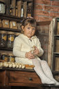 Little girl on the old kitchen photos in retro style Stock Image