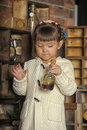 Little girl on the old kitchen photos in retro style Royalty Free Stock Photo