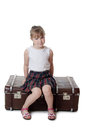 The little girl on old suitcases Royalty Free Stock Photo