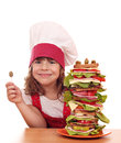 Little girl with olive and tall sandwich happy Royalty Free Stock Photography