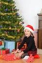 Little Girl Open Christmas Pre...