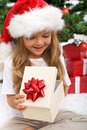 Little girl opening christmas present Stock Image