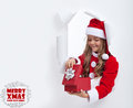 Little girl opening christmas present with lots of copy space Royalty Free Stock Images