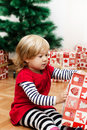 Little girl opens the gift cute a christmas at home Royalty Free Stock Images