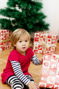 Little girl opens the gift cute a christmas at home Royalty Free Stock Photos
