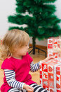 Little girl opens the gift cute a christmas at home Stock Photography