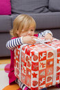 Little girl opens the gift happy a christmas at home Stock Photos