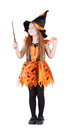 Little girl in orange costume of witch for Halloween Royalty Free Stock Photo