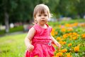Little girl in orange flowers Royalty Free Stock Photos