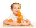 Little girl with oranges drink juice with  straw Royalty Free Stock Photo