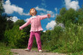 Little girl outdoor looks upward Royalty Free Stock Photos