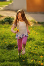 Little girl outdoors beautiful running Stock Photos
