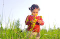 Little girl outdoors in high grass Royalty Free Stock Photo