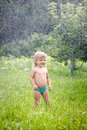 Little girl outdoors in rain this image has attached release Royalty Free Stock Images