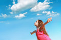 Little girl outstretched arms and closed her eyes  enjoying and Royalty Free Stock Photo