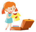 Little girl packing suitcase