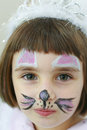 Little girl with paint on her face at a birthday party Royalty Free Stock Photos