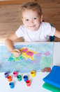 Little girl painting with brush smily Stock Photography