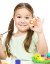 Little girl painting eggs preparing easter over white Stock Images