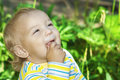 Little girl in park laughs against summer nature Stock Images