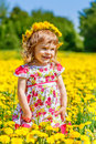 Little girl in the park playing spring Royalty Free Stock Photos