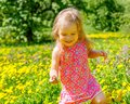Little girl in the park playing spring Royalty Free Stock Photo