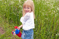 Little girl with patriotic bouquet in red pail Royalty Free Stock Photo