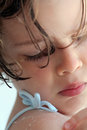 Little girl pealing seaside skin a small just woke up from bed Stock Image