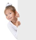 Little girl peeking from behind the advert isolated Royalty Free Stock Photo