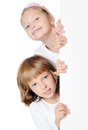 Little girl peeking from behind the advert isolated Royalty Free Stock Image