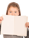 Little girl peeking from behind an open book Royalty Free Stock Photo