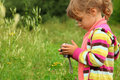 Little girl with photo camera outdoor Royalty Free Stock Photo