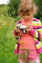 Little girl with photo camera outdoor Royalty Free Stock Images