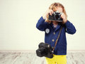 Little girl photographing child with camera Royalty Free Stock Photos